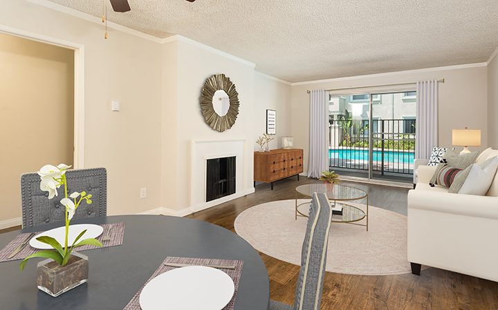 3D render of living room with fireplace at Playa Pacifica, Los Angeles apartments in Playa del Rey