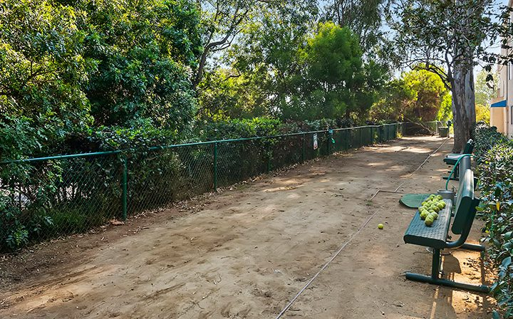 Dog park with benches and dirt path at Playa Pacifica, Los Angeles apartments in Playa del Rey