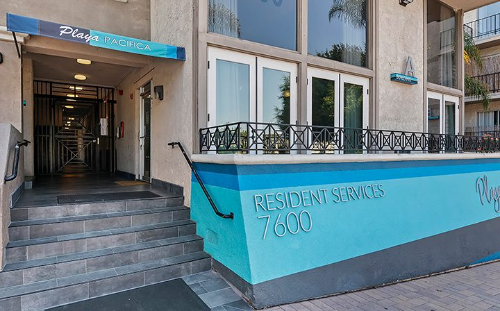 Playa Pacifica Resident Services entrance with blue accent, Playa del Rey apartments in Los Angeles