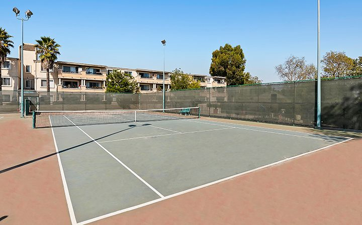 Large outdoor tennis court at Playa Pacifica, Los Angeles apartments in Playa del Rey