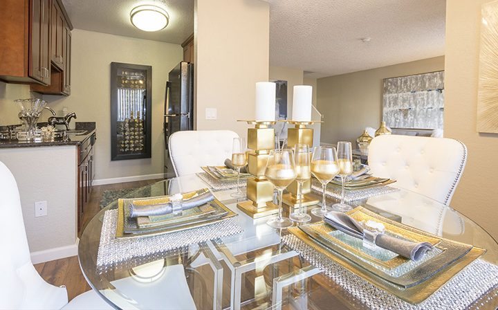 Furnished dining room with place setting at Rancho Luna Sol, Fremont apartments in the Bay Area
