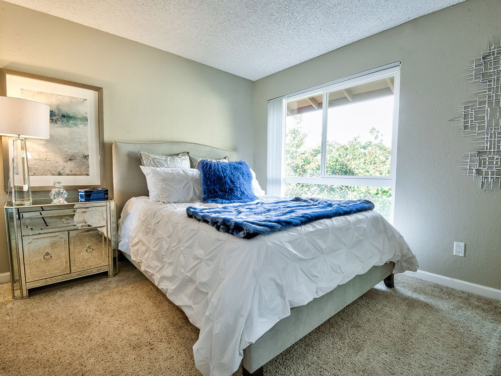 Furnished bedroom at Bay Area Fremont apartments Rancho Luna Sol