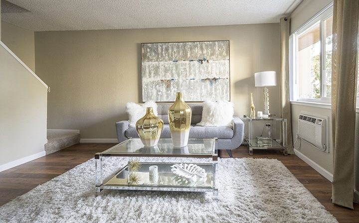 Furnished living room with white shag rug at Rancho Luna Sol, Fremont apartments in the Bay Area