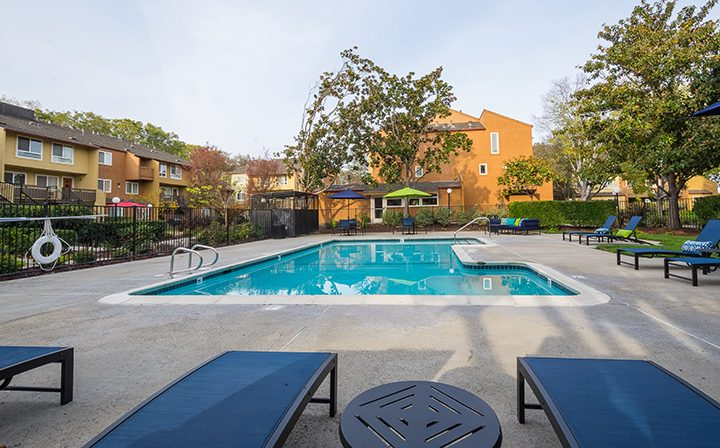 Large pool with blue reclining seating at Rancho Luna Sol, Fremont apartments in the Bay Area