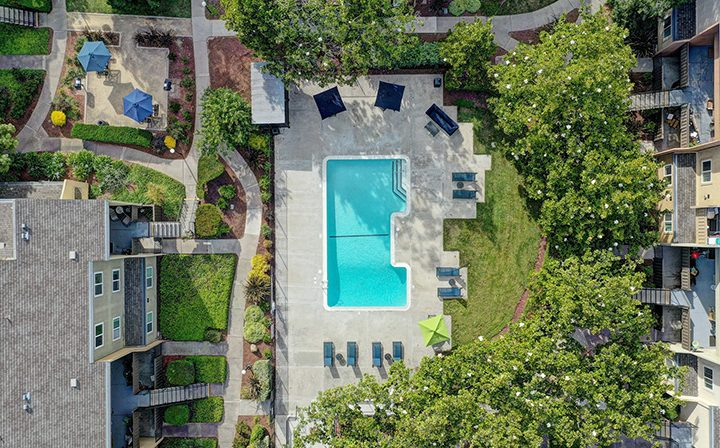 Aerial view of pool area and community at Rancho Luna Sol, Bay Area apartments in Fremont