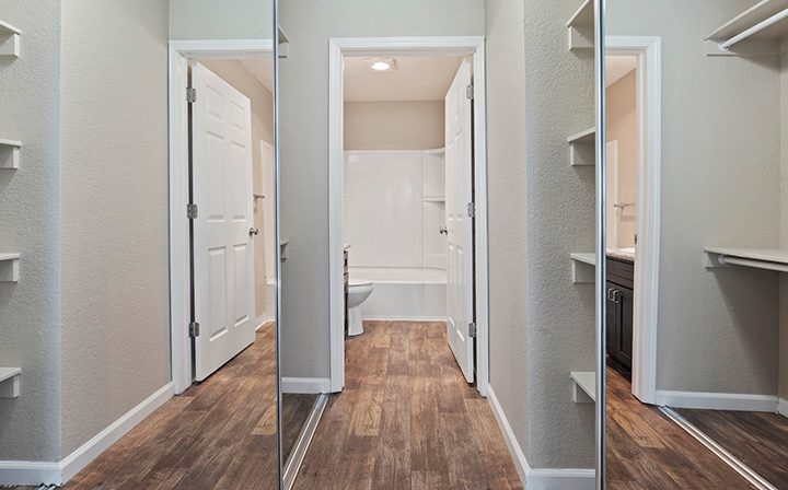 1 bedroom bathroom with mirrored closet doors