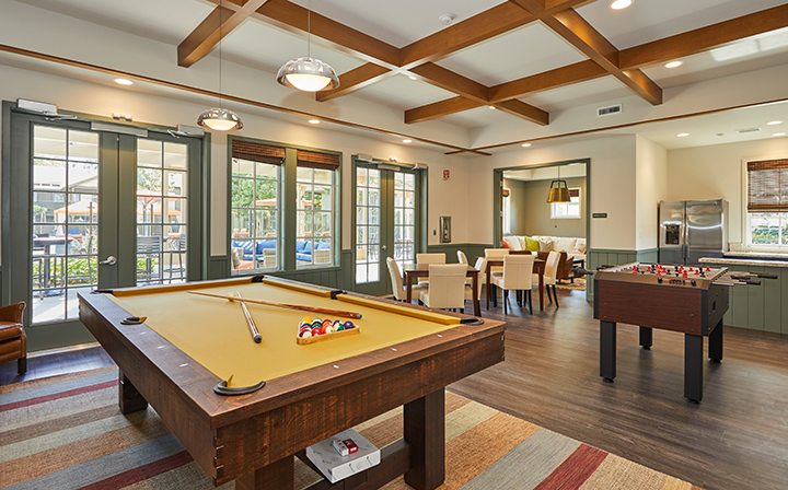 Billiards and foosball tables at the Reserve at Chino Hills apartments community clubhouse