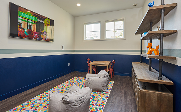 Colorful entertainment room with bean bag chairs and TV at the Reserve at Chino Hills apartments