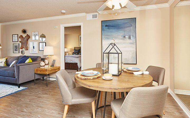 Colorfully furnished living room with hardwood floors at the Reserve at Chino Hills apartments
