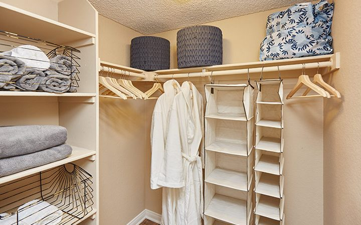 Large walk-in closet with shelves and ample storage space at the Reserve at Chino Hills apartments