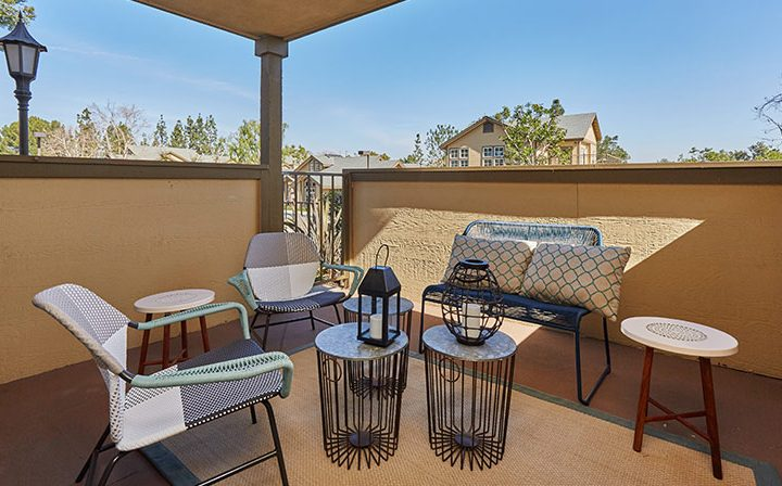 Large covered balcony with seating and beautiful view at the Reserve at Chino Hills apartments