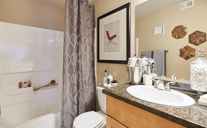 Furnished bathroom with bathtub shower combo at the Reserve at Chino Hills apartments