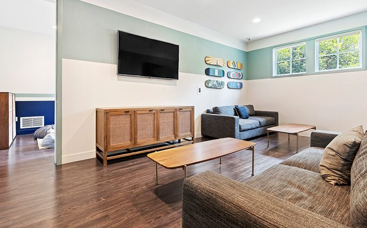 Lounge area at the Reserve at Chino Hills apartments community clubhouse
