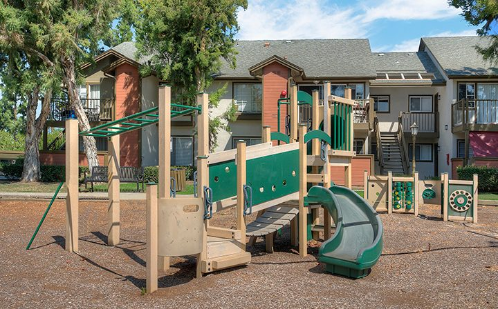 Playground with slide and monkey bars at the Reserve at Chino Hills apartments
