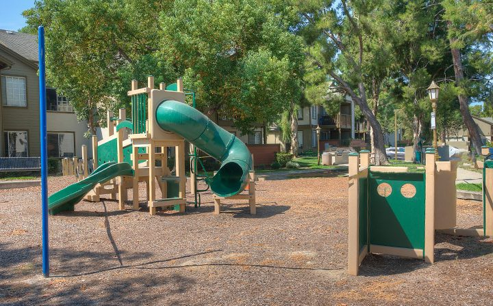 Children's outdoor playground with slide at the Reserve at Chino Hills apartments