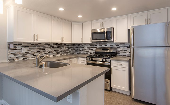 Large kitchen with range, microwave, and ample counter space at Adagio at South Coast apartments