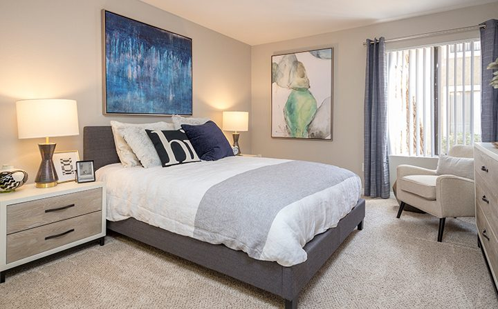 Furnished, newly renovated bedroom with sunny window view at the Reserve at South Coast apartments