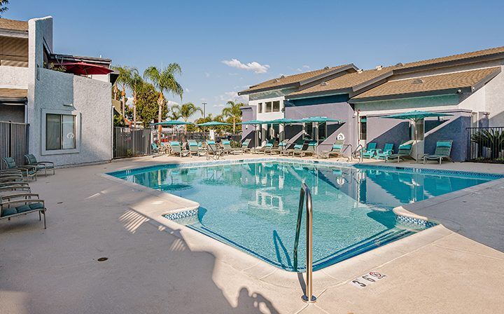 Newly renovated pool area with seating at the Reserve at South Coast apartments in Santa Ana