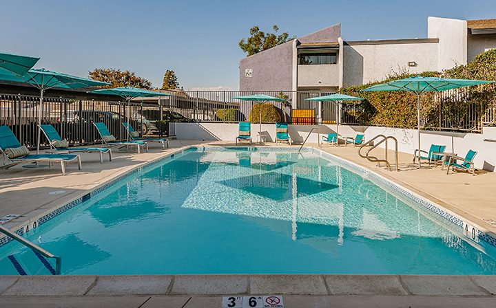 Second pool with colorful seating area at the Reserve at South Coast apartments near Costa Mesa