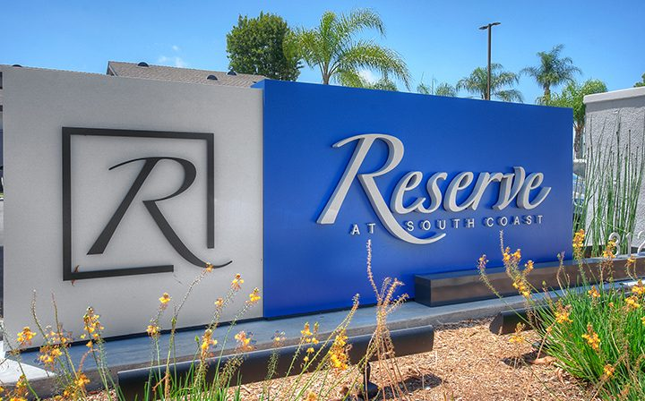Entry sign for the Reserve at South Coast apartments in Orange County