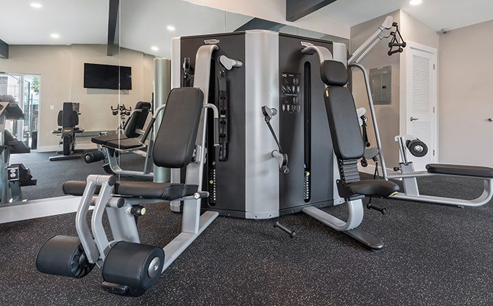 Large state-of-the-art exercise machines at the Reserve at Walnut Creek apartments gym