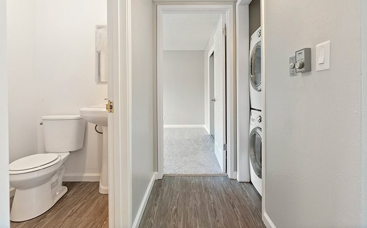 Bathroom hallway and washer dryer combo at the Reserve at Walnut Creek apartments