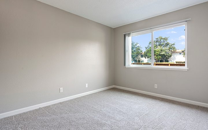 Unfurnished carpeted bedroom and window view at the Reserve at Walnut Creek apartments