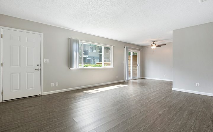 Unfurnished apartment with white walls and wood floors at the Reserve at Walnut Creek apartments