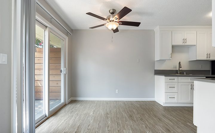 Patio exit and kitchen with ample natural light at the Reserve at Walnut Creek apartments
