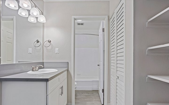 Bathroom with vanity mirror lights and closet at the Reserve at Walnut Creek apartments