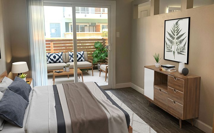 Furnished bedroom with patio exit at the Reserve at Walnut Creek apartments