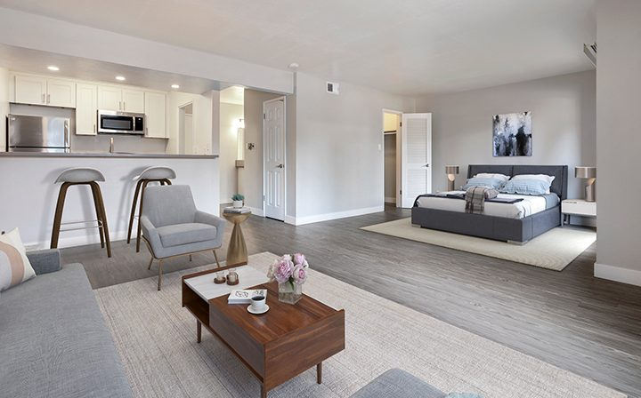 Furnished living room and bedroom area at the Reserve at Walnut Creek apartments
