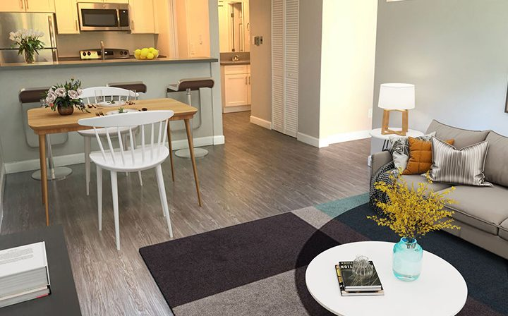Furnished kitchen, dining, and living room area at the Reserve at Walnut Creek apartments