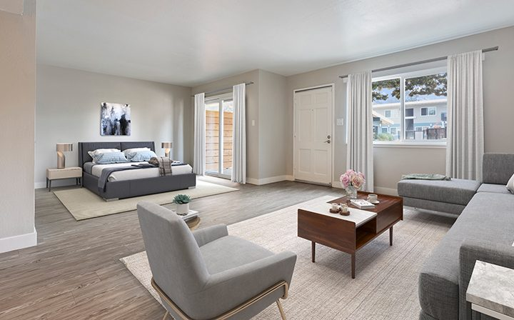 Furnished bedroom and living room area at the Reserve at Walnut Creek apartments