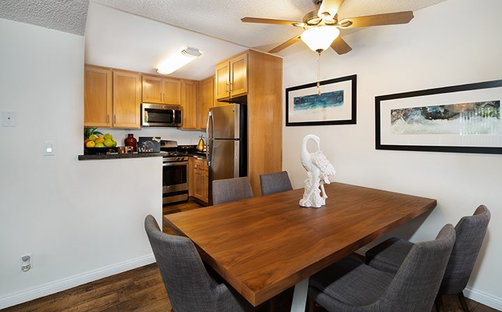 Furnished apartment interior at Simi Valley apartments River Ranch with wood floor and cabinets