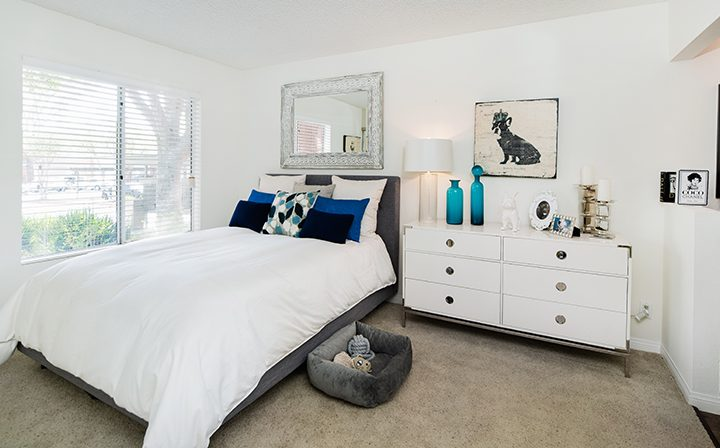 Sunny, spacious bedroom, adjacent to bathroom, at Simi Valley apartments community River Ranch