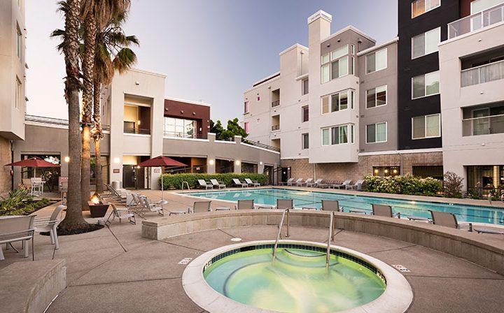 Spa beside pool below overlooking units at Bridgecourt, premier apartments in Emeryville
