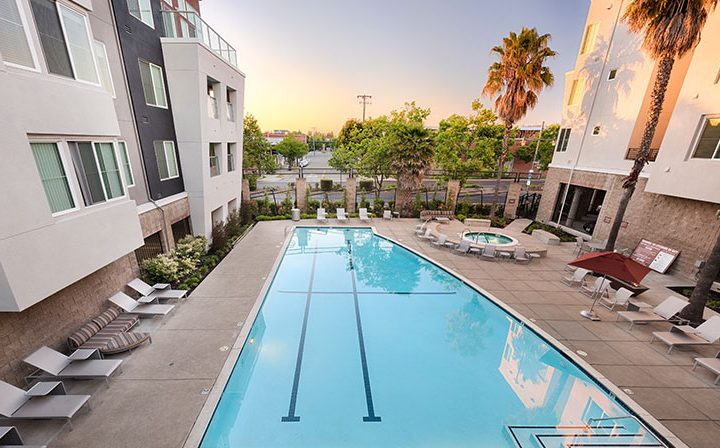 Aerial view of deluxe pool and seating at Bridgecourt, premier apartments in Emeryville