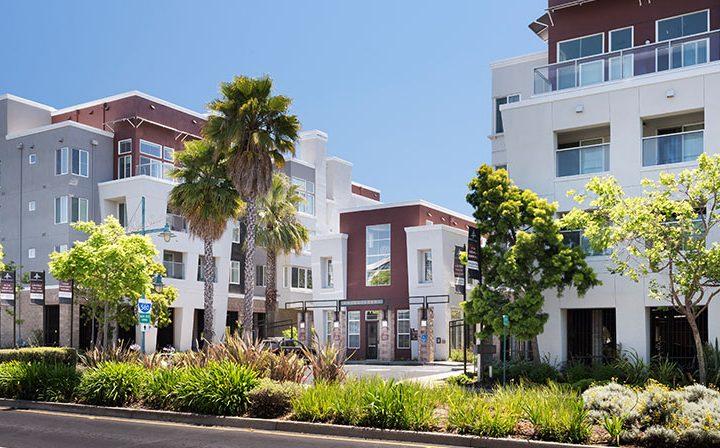 Daytime streetside view of Bridgecourt, an Emeryville apartment community