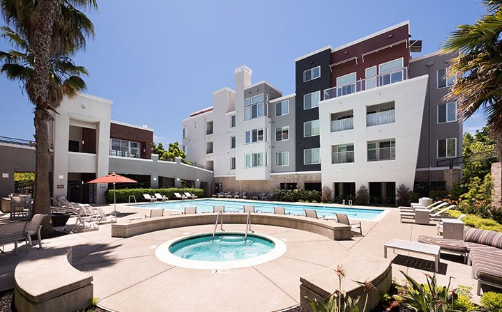 Stunning pool area with spa and curved pool at Bridgecourt, Emeryville apartments for rent