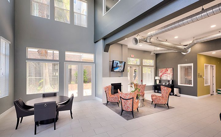 Elegant clubhouse interior with cushioned seating at the Bridge at Emeryville apartments community