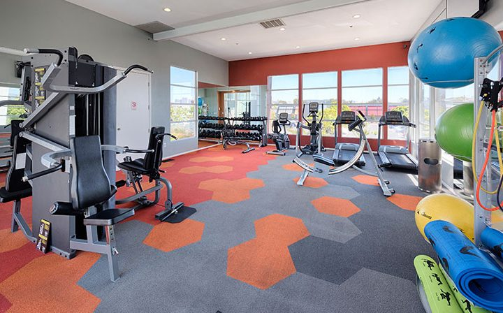 Colorful state-of-the-art fitness center at Bridgecourt, premier apartments in Emeryville