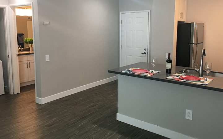 Unit entry area with kitchen and laundry machines visible at the Bridge at Emeryville apartments community