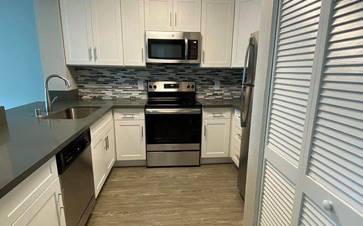 Unfurnished kitchen with hardwood floors at the Bridge at Emeryville apartments community