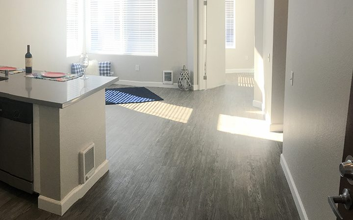 Unfurnished living room on sunny day at the Bridge at Emeryville apartments community