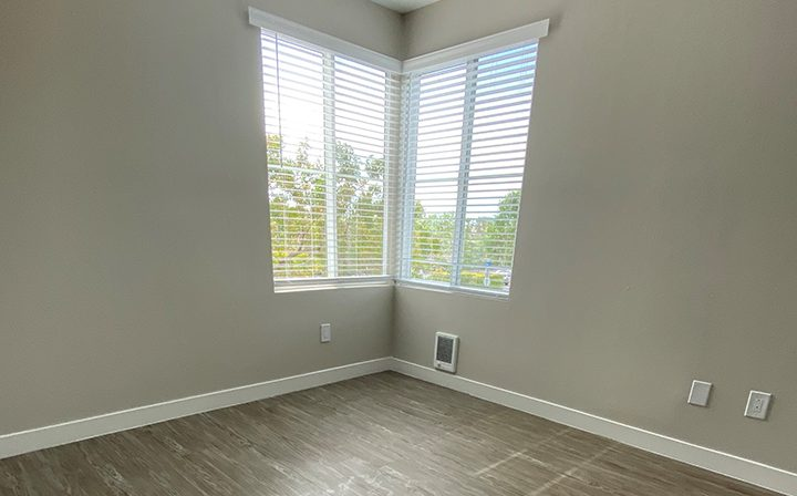 Unfurnished room with corner windows at the Bridge at Emeryville apartments community