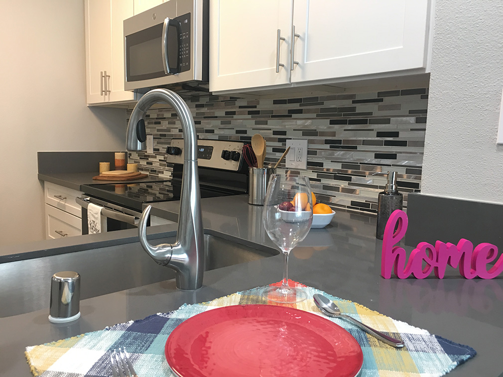Furnished kitchen at the Bridge at Emeryville apartments