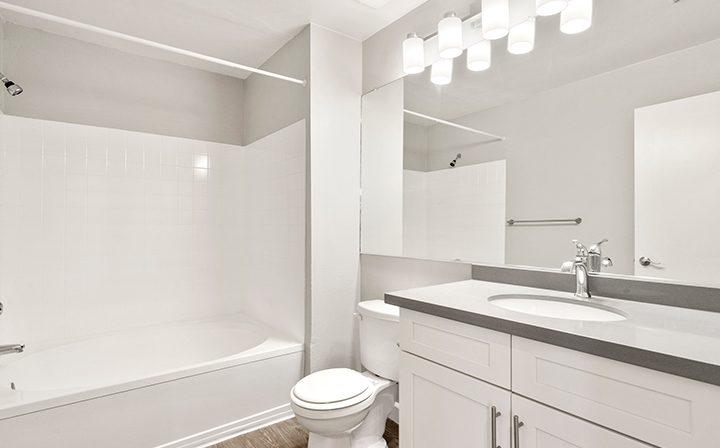 Brightly lit bathroom in the 1x1 Bay Bridge floor plan at the Bridge at Emeryville apartments