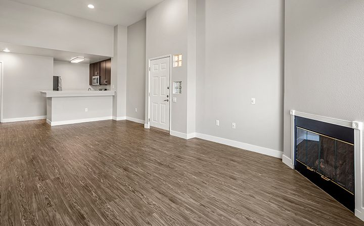 Living room with fireplace in the 2x2 Marina floor plan at the Bridge at Emeryville apartments