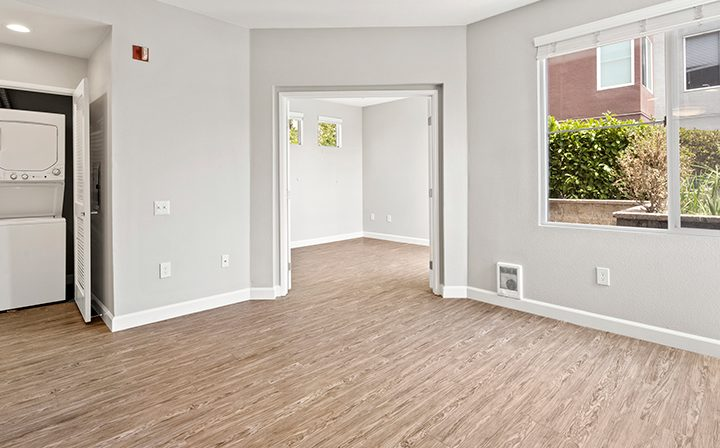 Bedroom with washer/dryer in the 1x1 Bay Bridge floor plan at the Bridge at Emeryville apartments